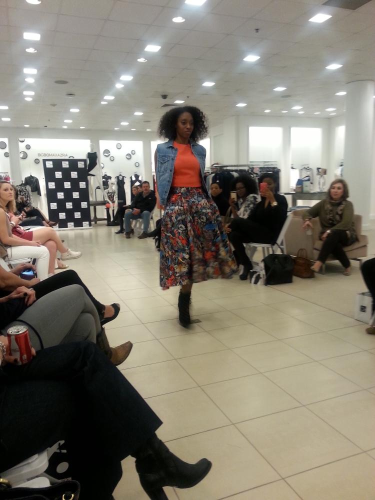 Slaying the season's trends - Denim Vest, Orange Tee, Full Vibrant Skirt